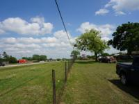 Potential, Potential! 7.64 acres+/- w/older home. Shop