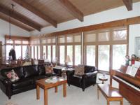 Stunning Crystal Lake year round home. Soaring wood