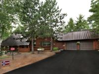 EAGLE RIVER CHAIN! This impressive Tomahawk log home is