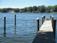 SPRING LAKE WATERFRONT HOME! You'll never tire of the