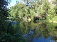 One of a kind property! Over 800 feet of Butte Creek