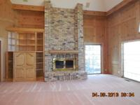 Custom built executive home on Willmar Lake with 1.79