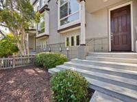 A stunning CLASSIC contemporary townhome located in the