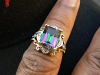 Available is this 3 Carat Emerald Cut Mystic