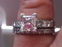 One Ladies 18KT White Gold Princess Cut Diamond Ring