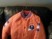 . Two traditional intense orange coats for youth in