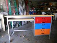 Awesome metal desk. 3 drawers, red blue and orange.