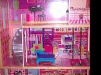 It a 3 floor doll house. About 4 ft tall. It in good