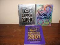 These are 3 Guinness World Records Books. The 2000 book