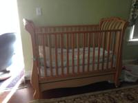 A Pali Solid Wood Crib that converts from crib to