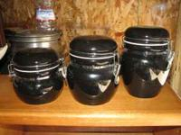 Set of 3 matching black ceramic canisters with