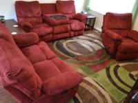 Red, microfiber couch, love seat and recliner. 2 yrs.