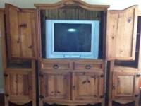3 pc. t.v. center, t.v. included, real wood, lots of