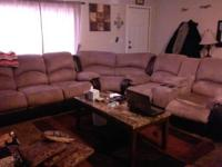 A 3 piece suede sectional with 4 recliners and