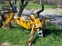 THIS IS A TAYLOR MADE BACK HOE WORKS GREAT I JUST DO