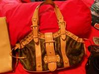 This is 3 purses for $50 . @ very nice purses tan