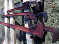 Have a trine large wrenches, made by The Ridge Tool Co.