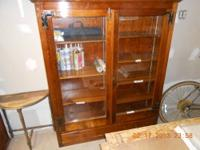 (7) gun storage cabinet with (2) drawers on the bottom