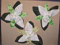 3 hand made trillium flowers are fashioned from high