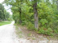 3 wooded acres between Stockton lake and Greenfield Mo.