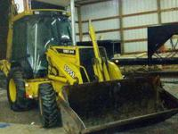 1999 JOHN DEERE 310 SE, Good running machine has no