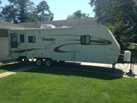 We have a 30' ultralite pull behind travel trailer that