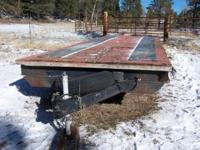 "30' flatbed trailer. Bed is 26' x 8', 2'10"" high. Takes"