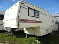 This 30 ft Carrilite 5th wheel is a fresh trade and