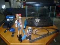 30 gal. Tank - fish food - cleaning supplies - filters