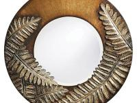 This round frame mirror features a brushed bronze