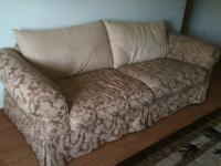 Large, comfortable beige used couch. Very small hole in