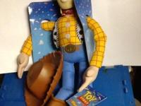 New, Plush Woody toy. Hard plastic helmet. Original