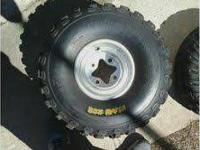 i am selling a set of four wheeler tires w/rims. they