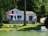 Roomy lakefront home on a sandy and clear all sports