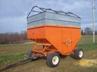 Gravity box, 300 bushel. Good running gear. $1500. Call