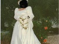 Formal Ivory Wedding Gown. Beautifully embroidered lace