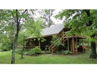 LOG HOME & ACREAGE IN ARKANSAS This log home has three