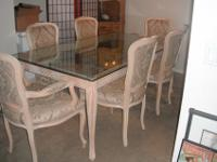Gorgeous Dining room glass table that seats 6. Chairs