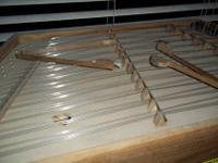 Large hammered dulcimer includes 2 sets of hammers and