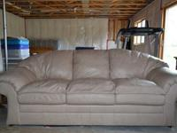 Super nice 100% leather couch, color is tan. The top