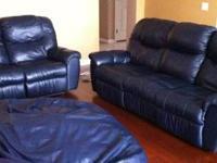 Beautiful tan microfiber dual recliner sofa! It has a
