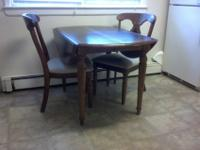 - Solid dining table, with 2 side drop-leaves.- Insert