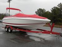 Boat comes with matching red Bimini Top which can cover