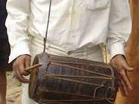 We are selling a vintage hand-drum purchased in the