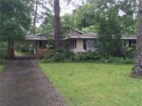 This spacious 3BR home is located on a corner lot in