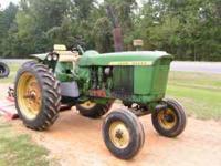 3010 john deere tractor with 6ft. bushog brand bushog
