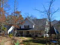 Just minutes to town but very peaceful, this 4BR/4BA