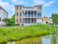 Spacious waterfront custom home with deeded boat slip