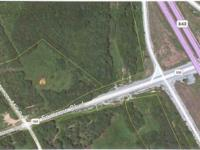 ALMOSY 14 ACRES RIGHT AT I840, AT THE CORNER OF