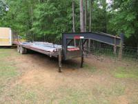 I HAVE A 30+ FOOT GOOSE NECK HEAVY DUTY TRAILER WITH 10